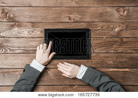 Close up of female hands touching screen with finger on tablet pc computer