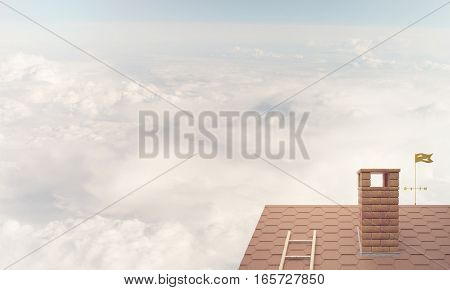Brown brick roof with chimney against blue sky background. Mixed media