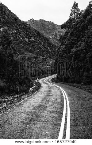 Road And Mountains In The Tasmanian Countryside. Black And White.