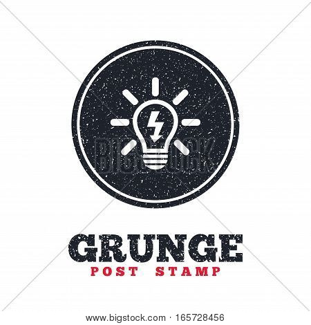 Grunge post stamp. Circle banner or label. Light lamp sign icon. Bulb with lightning symbol. Idea symbol. Dirty textured web button. Vector