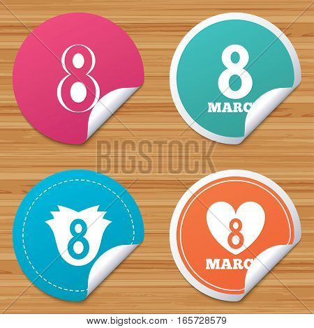 Round stickers or website banners. 8 March Women's Day icons. Tulip or rose flower and heart sign symbols. Circle badges with bended corner. Vector