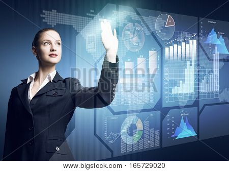 Pretty businesswoman working with virtual panel interface