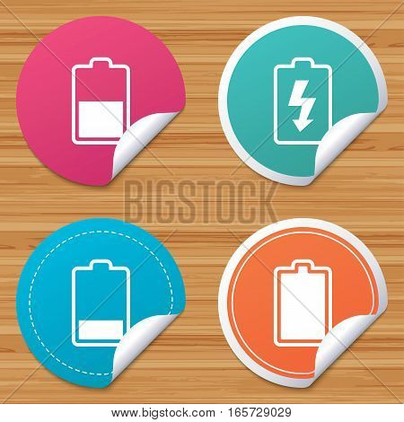 Round stickers or website banners. Battery charging icons. Electricity signs symbols. Charge levels: full, half and low. Circle badges with bended corner. Vector