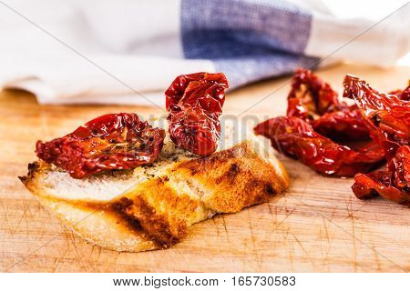Dried Tomatoes And Bread On Wood