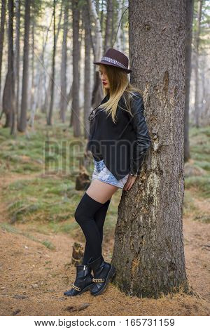 Beautiful Young Girl Walking In The Autumn Forest.