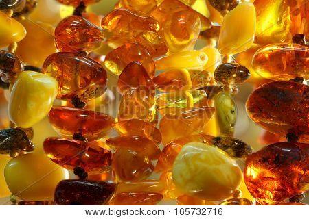 closeup various baltic amber necklaces  background texture outdoor