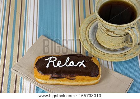 word relax on donut with black coffee
