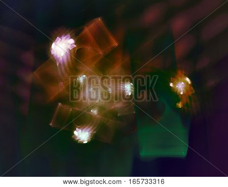 Fractal image of recurring shapes revolving around one another.