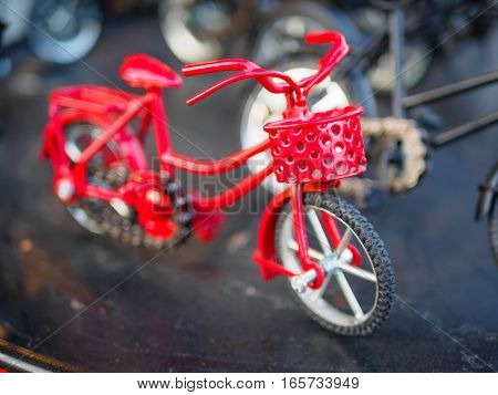 The red ,white and black small bicycle model