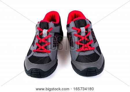 Gray And Pink Children's Sneakers On A White Background