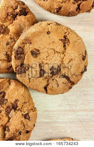A closeup of a pile of chocolate chips cookies, shot from above