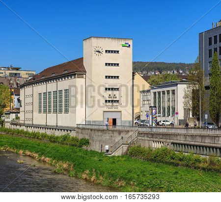 Zurich, Switzerland - 20 April, 2016: the Sihl river and buildings along it. The Sihl is a river that rises near the Druesberg mountain in the Swiss Canton of Schwyz and eventually flows into the Limmat river in the center of the city of Zurich.