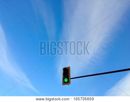 During day with bright blue sky circulation light at green
