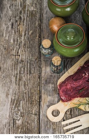 Beef Steak With Fresh Herbs On Wooden Board.