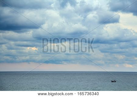 Seascape with fisherman boat in Mediterranean sea near shore of Tunisia