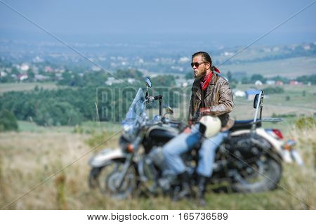 Brutal Biker Sitting On His Motorcycle On A Sunny Day