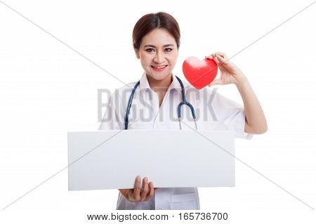 Young Asian Female Doctor With Red Heart And Blank Clipboard.