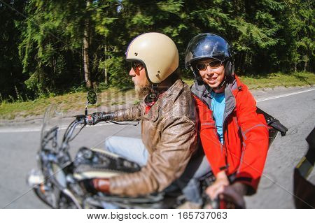Biker Riding His Motorcycle On The Road With The Passenger