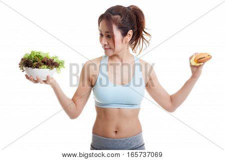 Beautiful Asian Healthy Girl With Salad And Hamburger.