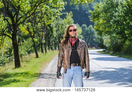 Portrait Of Biker Man With Beard Standing On The Road
