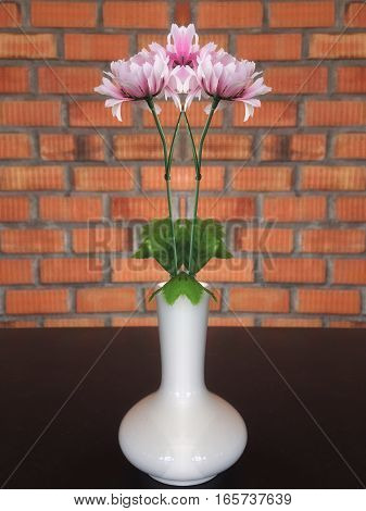 Pink flower in vase in table decoration
