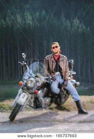 Biker Standing By His Custom Made Cruiser Motorcycle