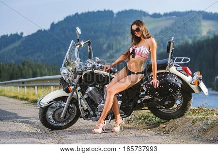 Young Sexy Girl Sitting On Custom Made Cruiser Motorcycle