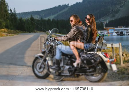 Couple Riders Sitting Together On Shiny Custom Made Cruiser Motorcycle