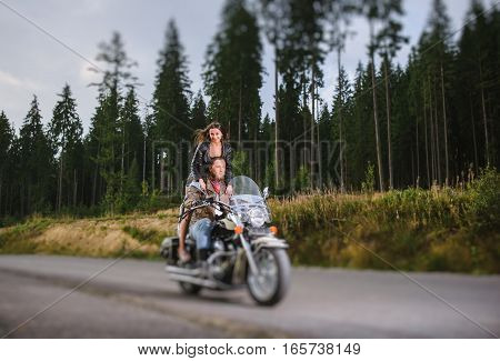 Couple Driving Their Travel Motorbike On The Open Road