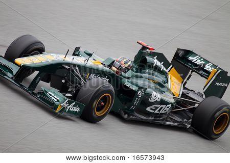 Close up of Heikki Kovalainen on a high speed straight