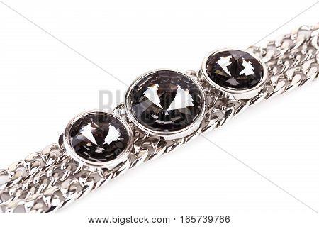 Stylish bracelet with stones isolated on a white background.