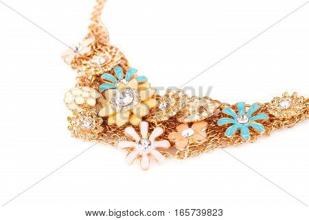 Stylish necklace with stones on a white background.