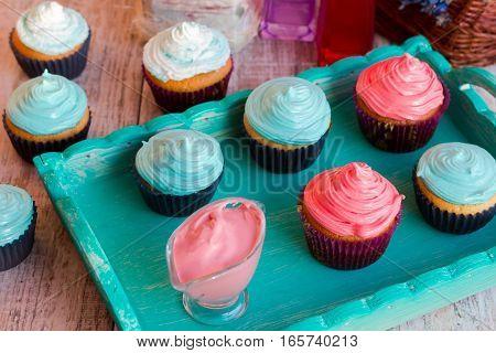 Homemade vanilla cupcakes with raspberry and mint cream