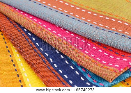 Colorful kitchen towels horizontal close up picture.