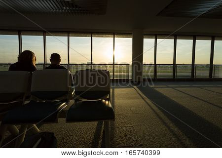Couple Love Traveler Waiting Flight Airplane In Airport Terminal