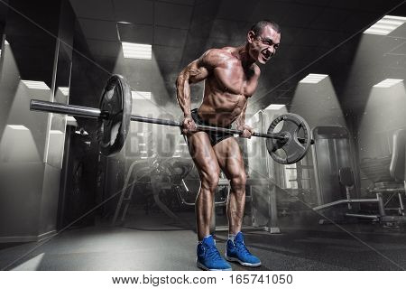 Muscular Man Doing Heavy Deadlift Exercise in gym