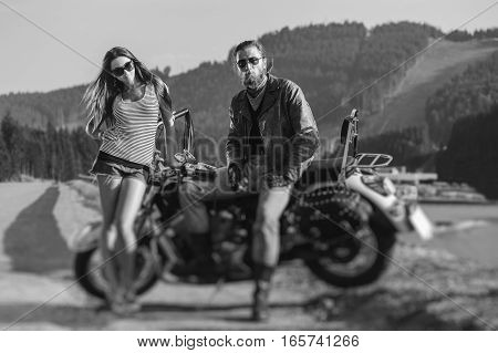 Couple Sitting On A Motorbike