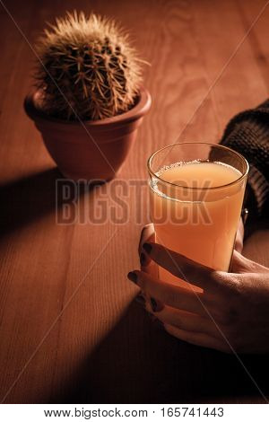 The Girl Holding A Glass Of Juice.