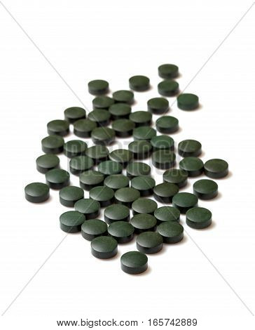 spirulliny in tablets isolated on white background