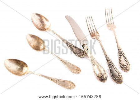 Vintage spoons knife and forks isolated on white background.