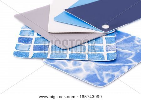 Swimming pool coating color samples on white background.