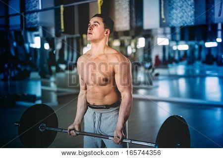 Athletic Muscular Man, Fitness Trainer Working Out At Gym And Making Biceps Exercices
