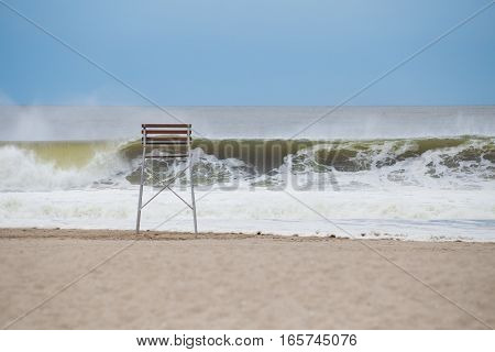Big hurricane wave pounding at empty beach photographed in September in Rockaway Beach NY