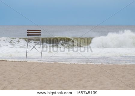Big hurricane wave breaking at empty beach photographed in September at Rockaway Beach NY