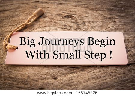 big journeys begin with small steps concept text