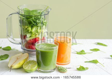 Green smoothie with blender and fruits health diet lifestyle concept