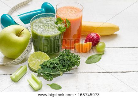 Fruits, vegetables, juice, smoothie and dumbell health diet and fitness lifestyle concept