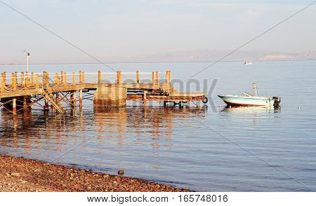 Red Sea Coastline with Boat and Wooden Jetty