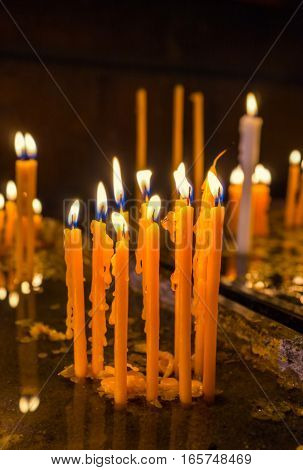 The wax drops from the burning candles to the tray with water Yerevan Armenia.