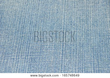 Closeup blue jean texture background, textile weaving